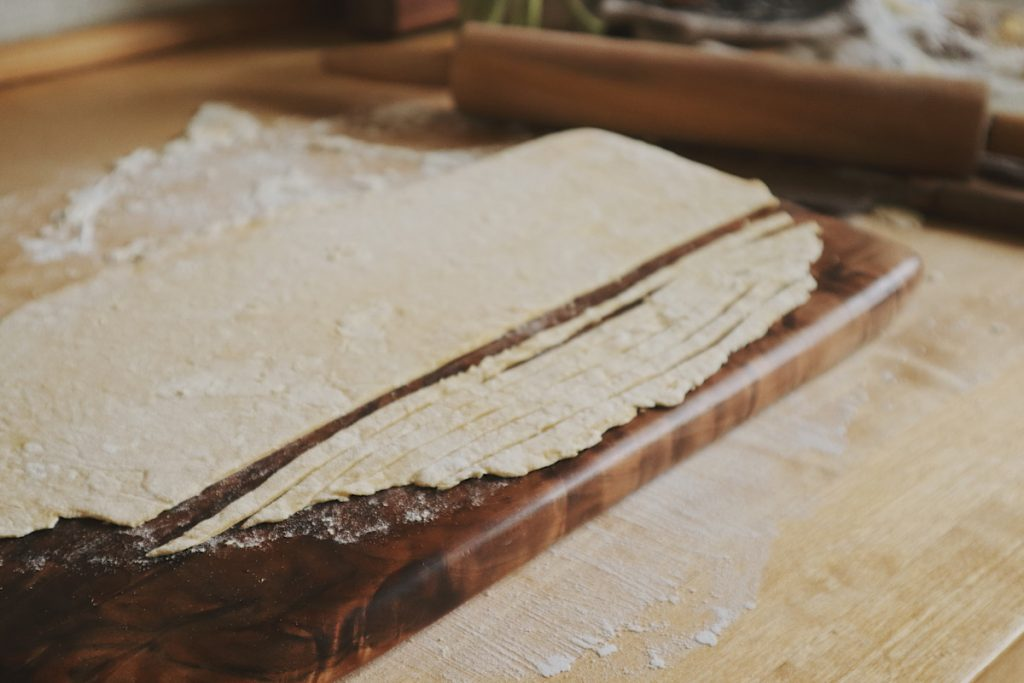 Verity Folk School handmade egg noodles on a wooden cutting board