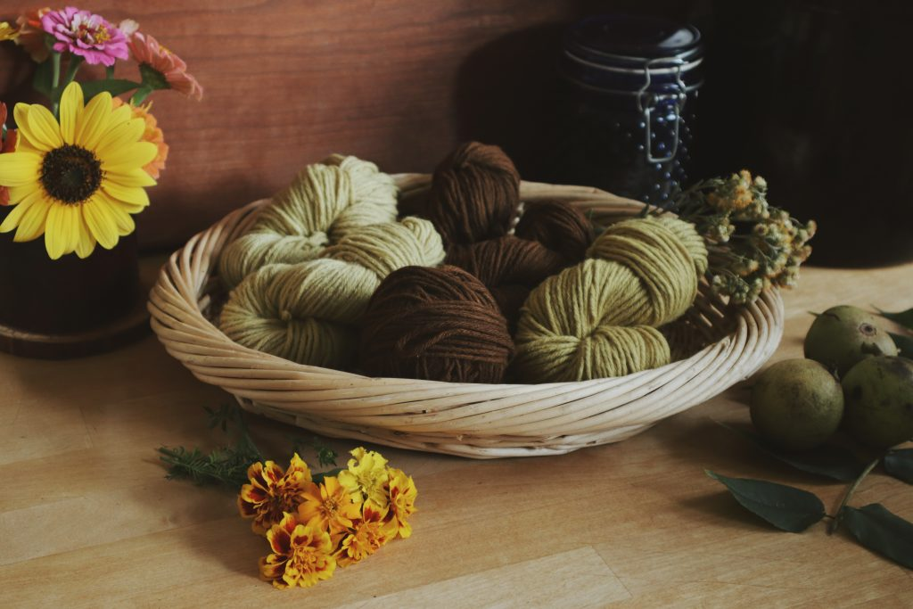 Verity folk School dyeing wool naturally with plants basket of plant dyed wool yarns