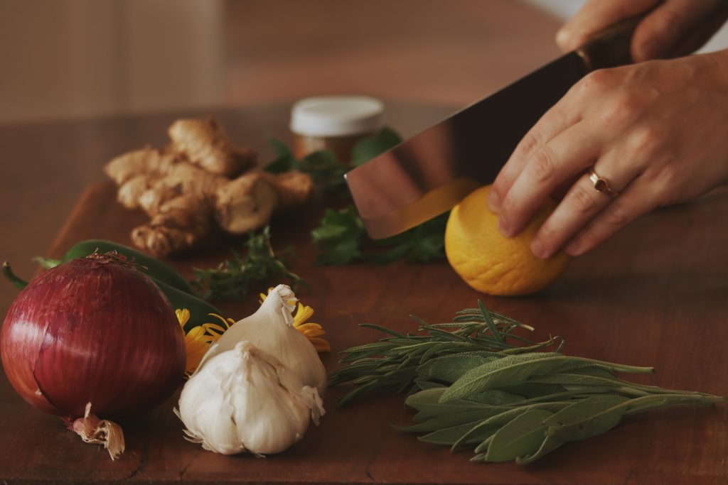Verity Folk School woman chopping lemons on a wooden cutting board