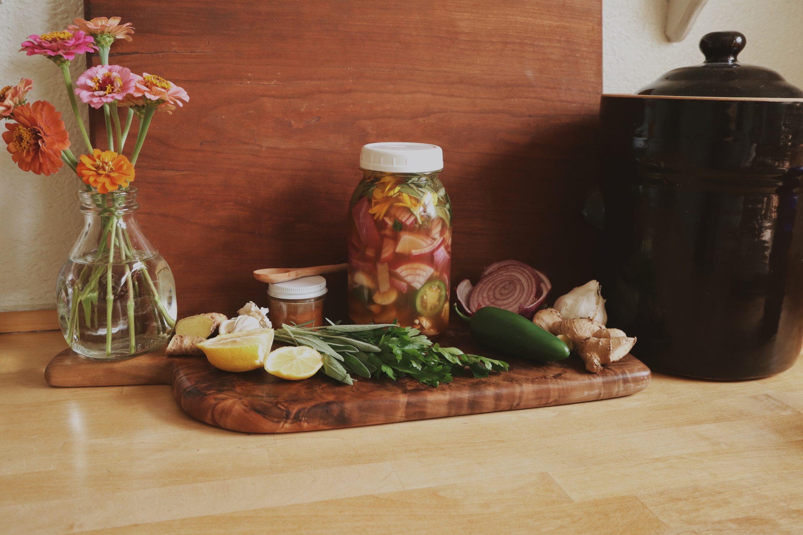 Verity folk school traditional Fire cider herbal remedy on a wooden cutting board