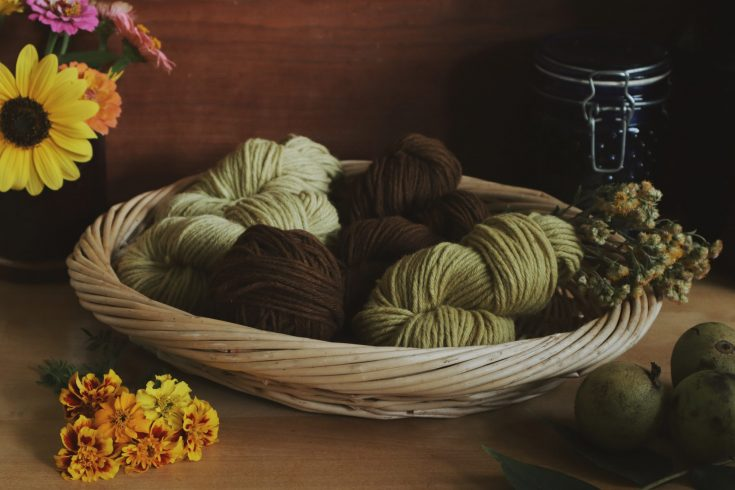 Verity Folk School Woven basket filled with plant dyed wool yarns